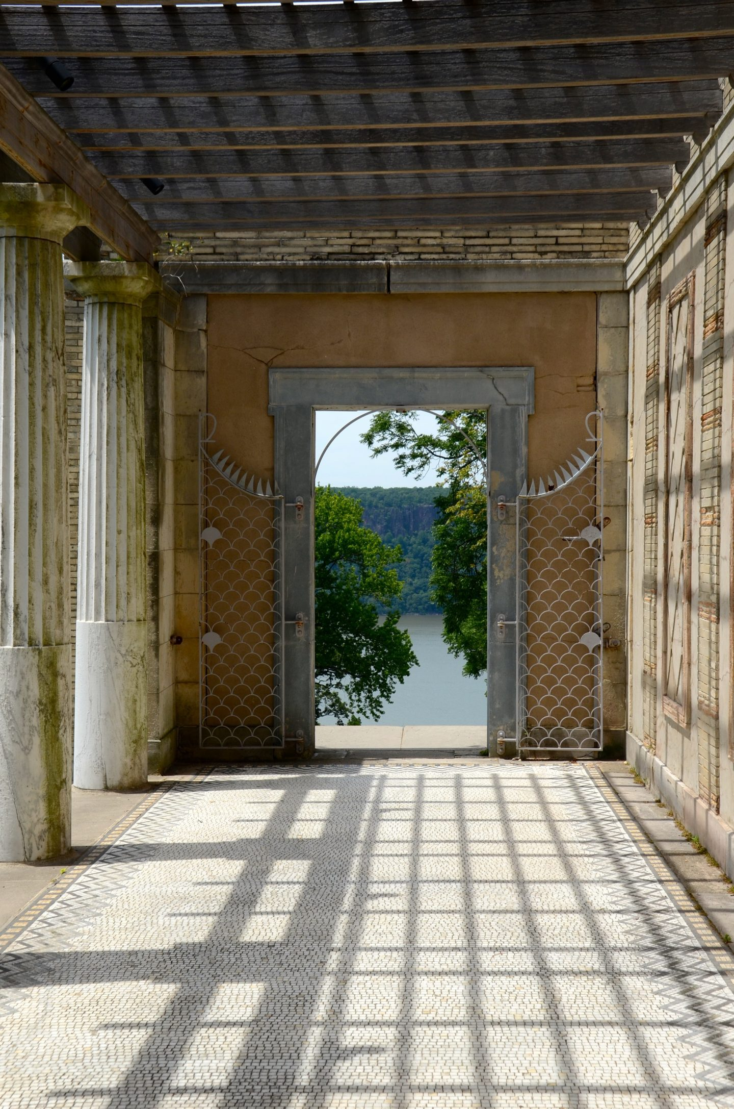 View of the Hudson River through a doorway at Untermyer Park and Gardens in Yonkers New York.