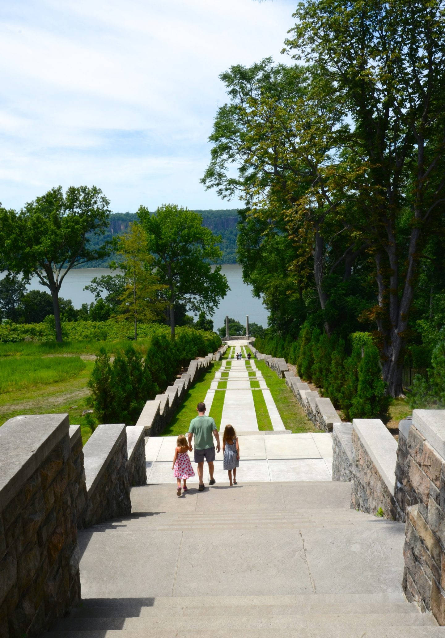 Walking down the grand staircase to the Hudson River at Untermyer Park and Gardens in Yonkers New York.