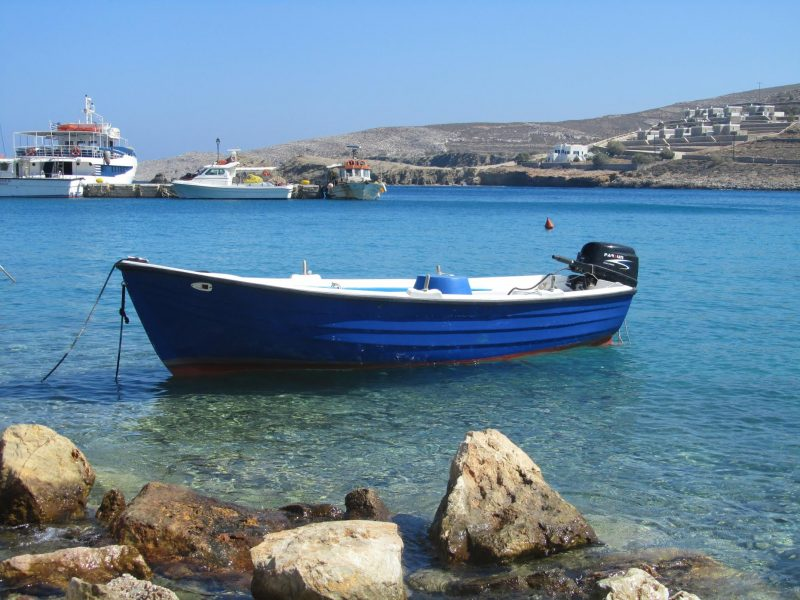 Pretty harbor in the Greek Islands with small boat.