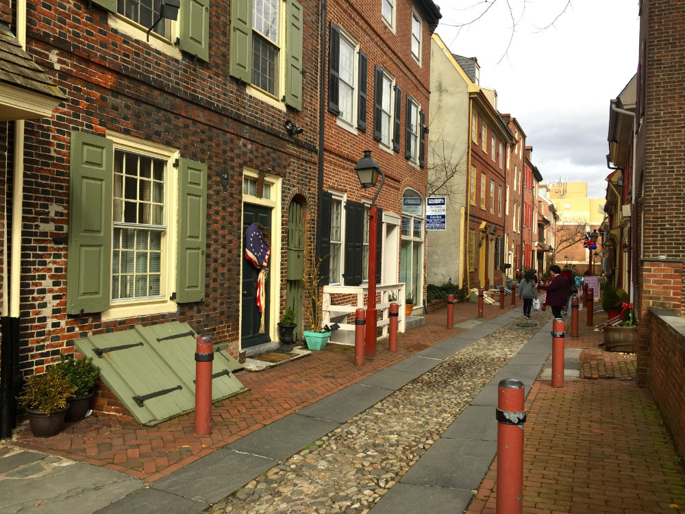 Walking on Elfreth Alley in Pennsylvania, the oldest street in America.