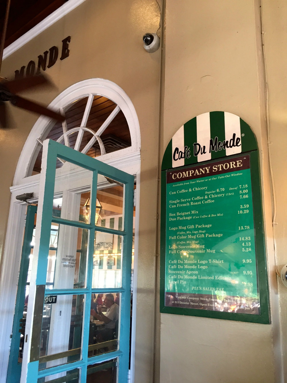 Eating beignets at Cafe du Monde in the French Quarter in New Orleans.