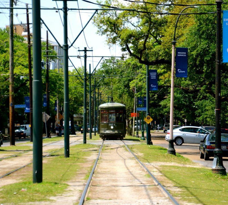 Riding the streetcar with kids in New Orleans.