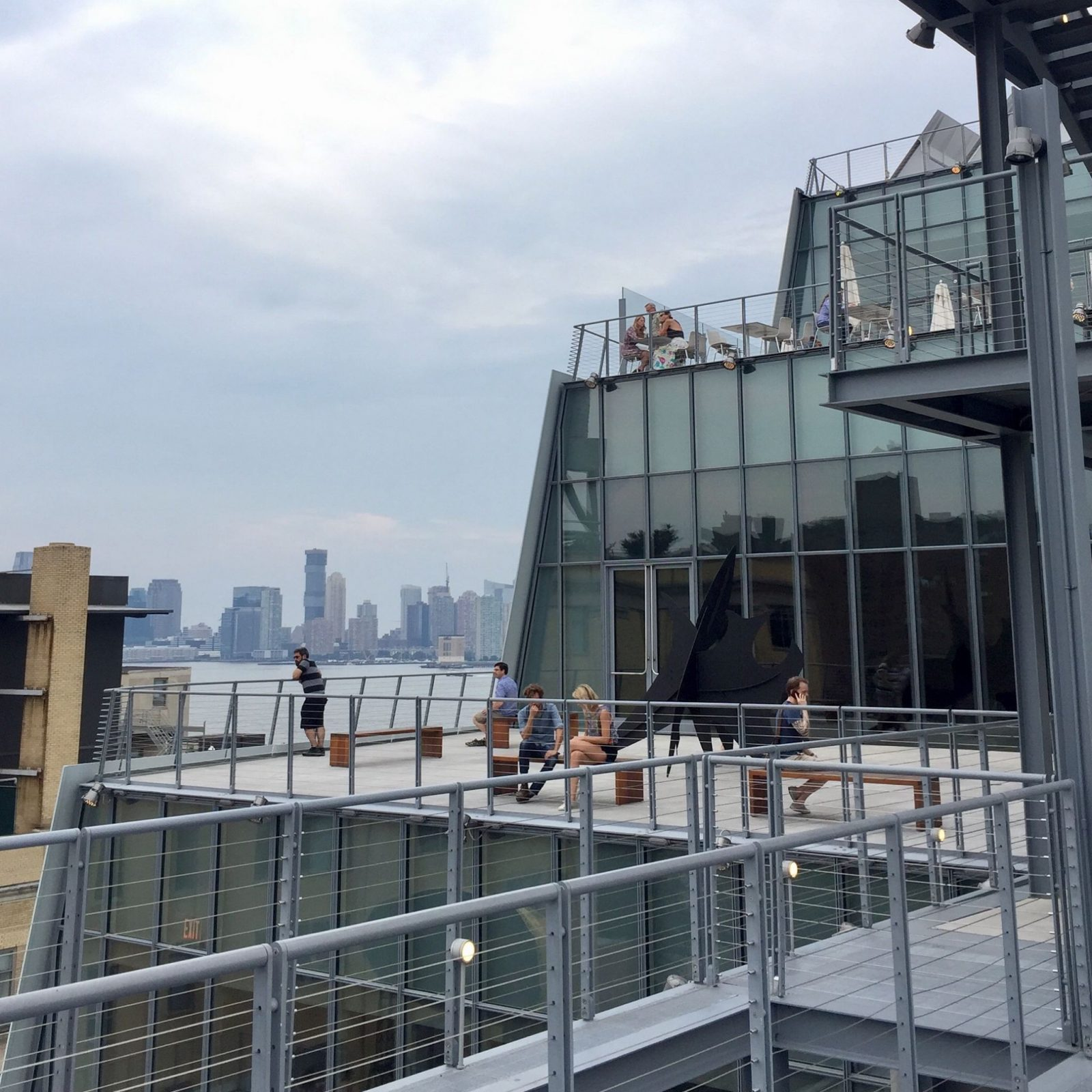 Outside on the deck at the Whitney Museum in New York in the summer.