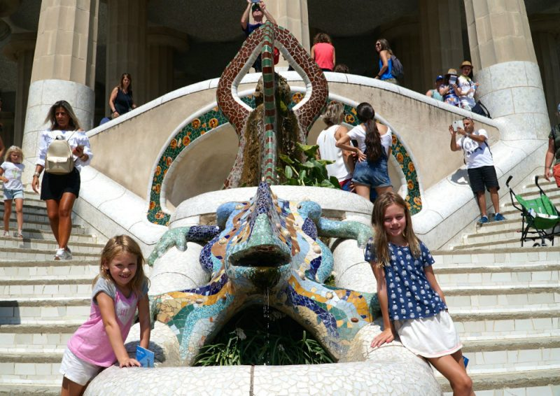 Girls with mosaic lizard at Park Guell, designed by Gaudi.